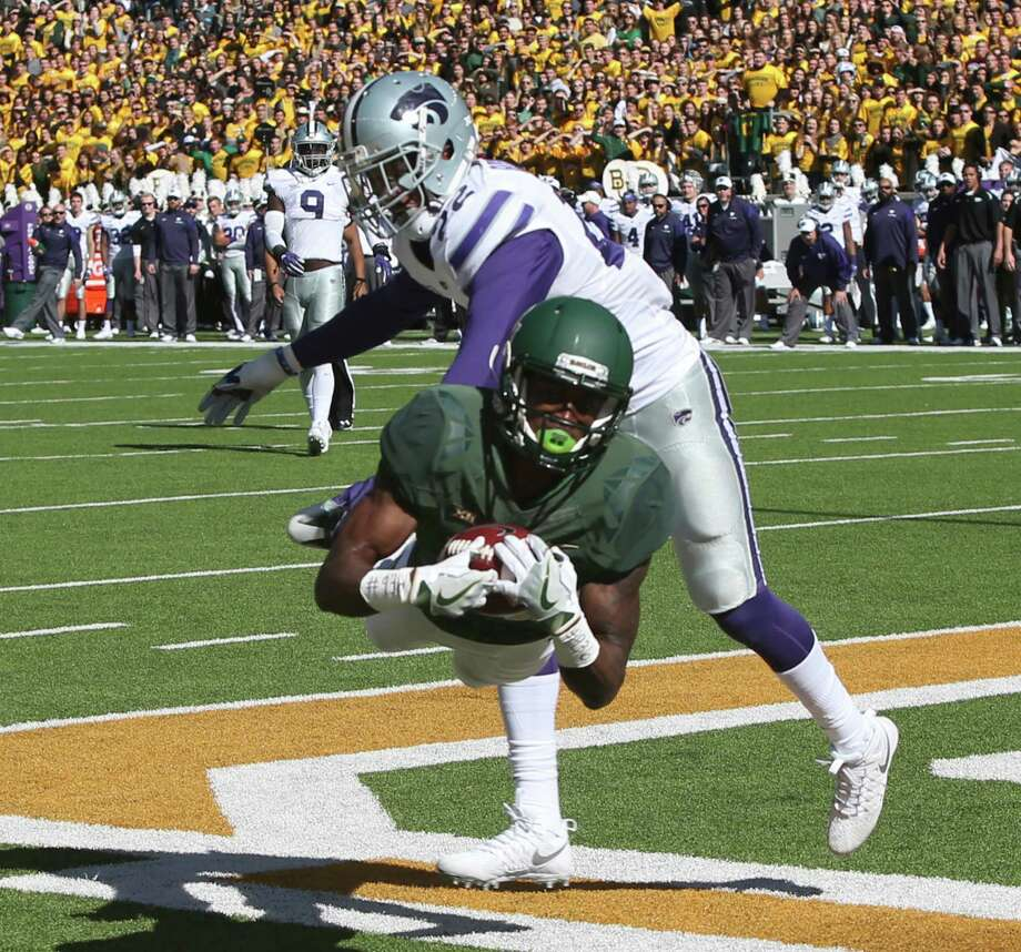 Baylor wide receiver Chris Platt scores on Kansas State defensive back Dante Barnett, right, in the first half of a NCAA college football game, Saturday, Nov. 19, 2016, in Waco, Texas. (Michael Bancale/Waco Tribune Herald, via AP) Photo: Michael Bancale, MBO / Waco Tribune-Herald