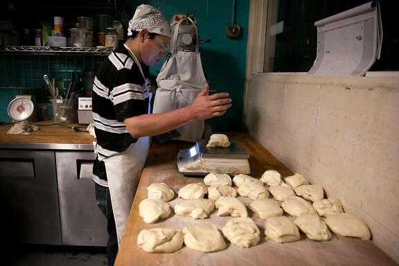Cesar Rolando Canales, a baker, prepares the bread at La Victoria, on Tuesday, Nov. 22, 2016 in San Francisco, Calif.