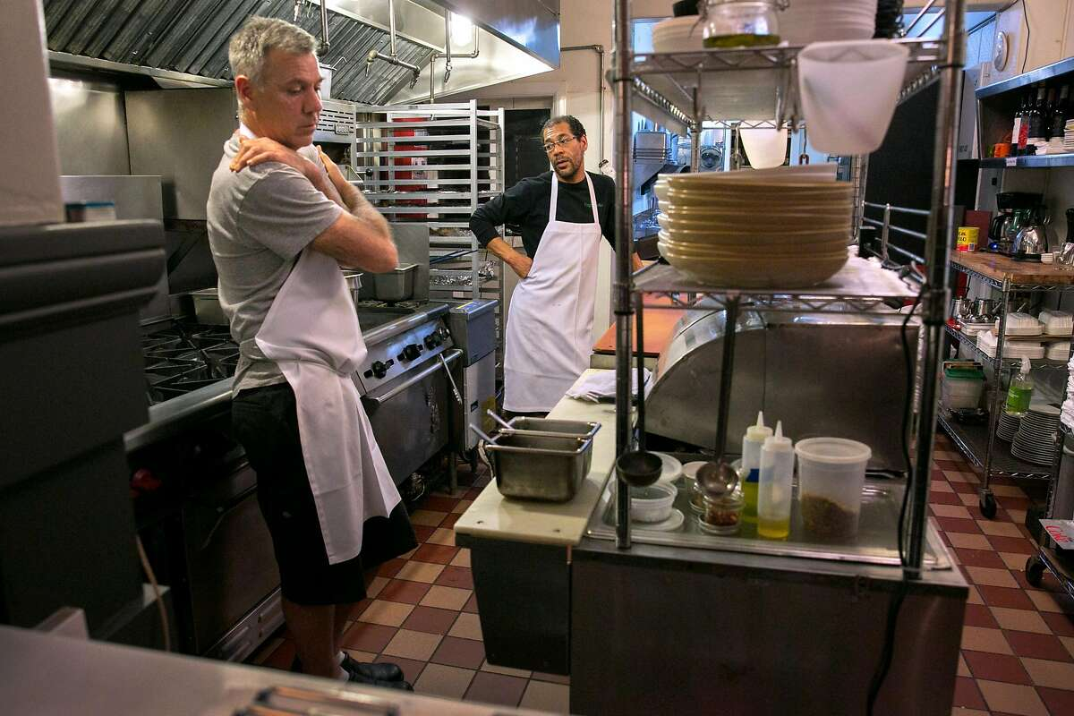 From left: Owners Barry Moore and Aaron Presbrey wait for customers during a slow business night at Roosevelt Sip 'N' Eat, on Tuesday, Nov. 22, 2016 in San Francisco, Calif.