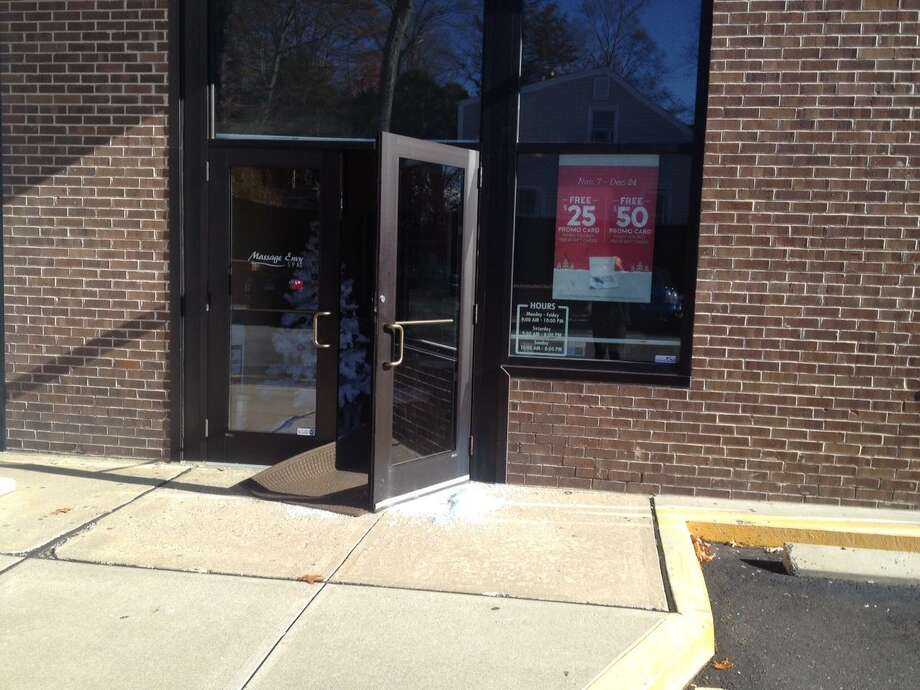 The glass door to Massage Envy on High Ridge Road had already been repaired, but shattered glass remained on the ground Tuesday morning. The Business was one of five on High Ridge Road that had rocks thrown through their front doors early Tuesday morning. Photo: John Nickerson / Staff Photo