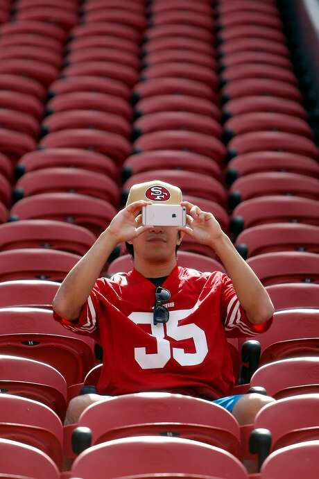 A 49ers fan who arrived early at Levi's Stadium in Santa Clara photographs the field before the game. Photo: Scott Strazzante, The Chronicle