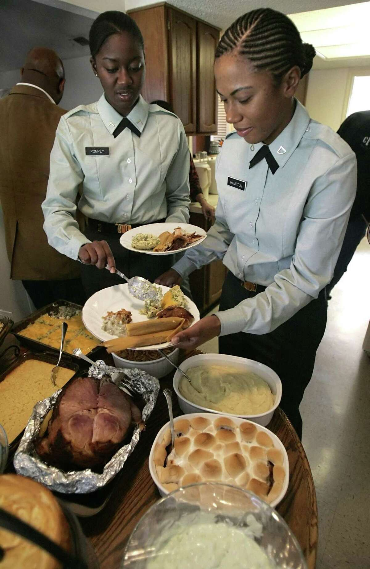 This file photo shows Ft. Sam Houston trainees enjoying Thanksgiving dinner as they spend the day with a local family as part of a program that pairs trainees with local families for the holiday. Happy Thanksgiving.