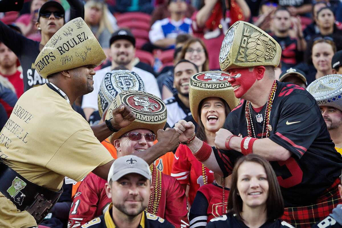 SANTA CLARA, CA - NOVEMBER 6: New Orleans Saints and San Francisco 49ers fans dressed up with championship ring hats pretend to face off on November, 6 2016 at Levi's Stadium in Santa Clara, California. The Saints won 41-23. (Photo by Brian Bahr/Getty Images)