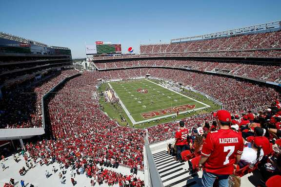 Fans at Levi's Stadium watch during an NFL preseason football game between the San Francisco 49ers and the Denver Broncos in Santa Clara, Calif., Sunday, Aug. 17, 2014. (AP Photo/Tony Avelar)