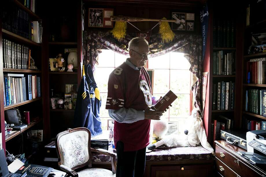 Long time 49er fan Dr. Tom Addison holds a souvenir that he received as a season-tickets holder at his home in Burlingame, Calif. on Wednesday, Nov. 23, 2016. Dr. Addison recently sold his $20,000 worth of seat-licenses for $8,000 as the team continues to perform poorly following the departure of Head Coach Jim Harbaugh, who is now the head coach at Michigan State where Dr. Addison is an alumni. Photo: Stephen Lam, Special To The Chronicle
