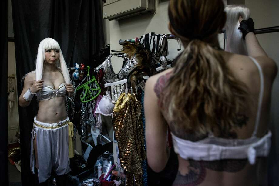TOKYO, JAPAN - JUNE 29: Performers  change into their costumes backstage prior to the start of a show at The Robot Restaurant on June 29, 2014 in Tokyo, Japan. The now famous Robot Restaurant opened two years ago in Kabukicho area of Shinjuku at an estimated cost of 10 million U.S. dollars.  Performances are held three times a day and cater mostly to foreign tourists. The cabaret style shows include bikini clad futuristic dancers, performers dressed as robots and a host of large scale robots and vehicles controlled with remotes by stage hands dressed as Ninjas  (Photo by Chris McGrath/Getty Images) Photo: Chris McGrath/Getty Images