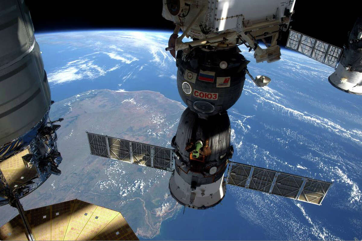 View from the International Space Station as it flies over Madagascar, showing three of five spacecraft docked to the station. Photo credit/NASA