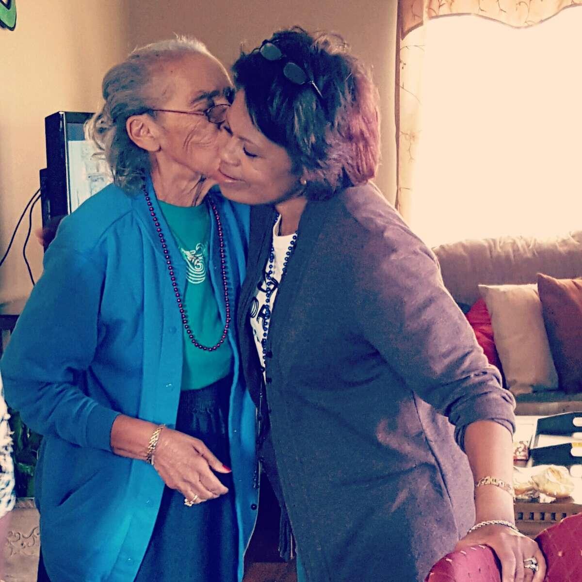 Grandma, left, kissing Mom's oldest sisterCarolyn.