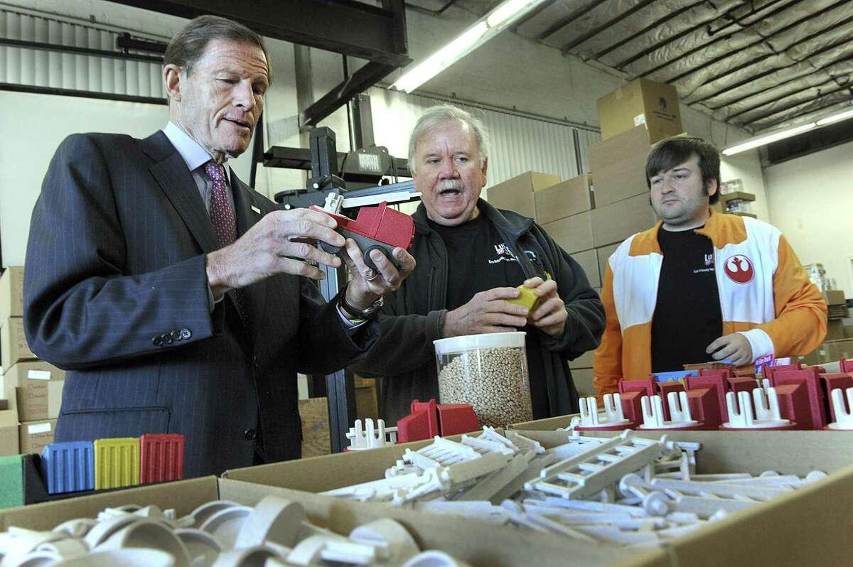 U.S. Sen. Richard Blumenthal left, gets a tour of Luke's Toy Factory in Danbury from owners Jim Barber and son, Luke Barber, Danbury Wednesday, Nov. 23, 2016.