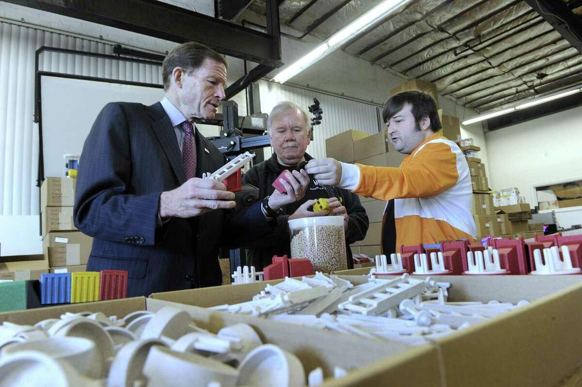 U.S. Sen. Richard Blumenthal, left, gets a tour of Luke's Toy Factory in Danbury from owners Jim Barber and son, Luke Barber, Danbury Wednesday, Nov. 23, 2016.