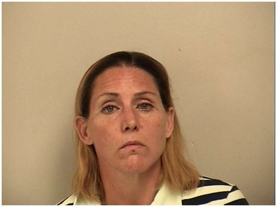 Sullivan , 40, of Norwalk, was charged with third-degree burglary and sixth-degree larceny, both from a motor vehicle, in Westport, Conn. on Nov. 18, 2016 after a Fairfield Police investigation resulted in her admission to multiple thefts from unlocked cars in the Saugatuck Elementary School parking lot. Photo: Westport Police / Contributed Photo / Westport News