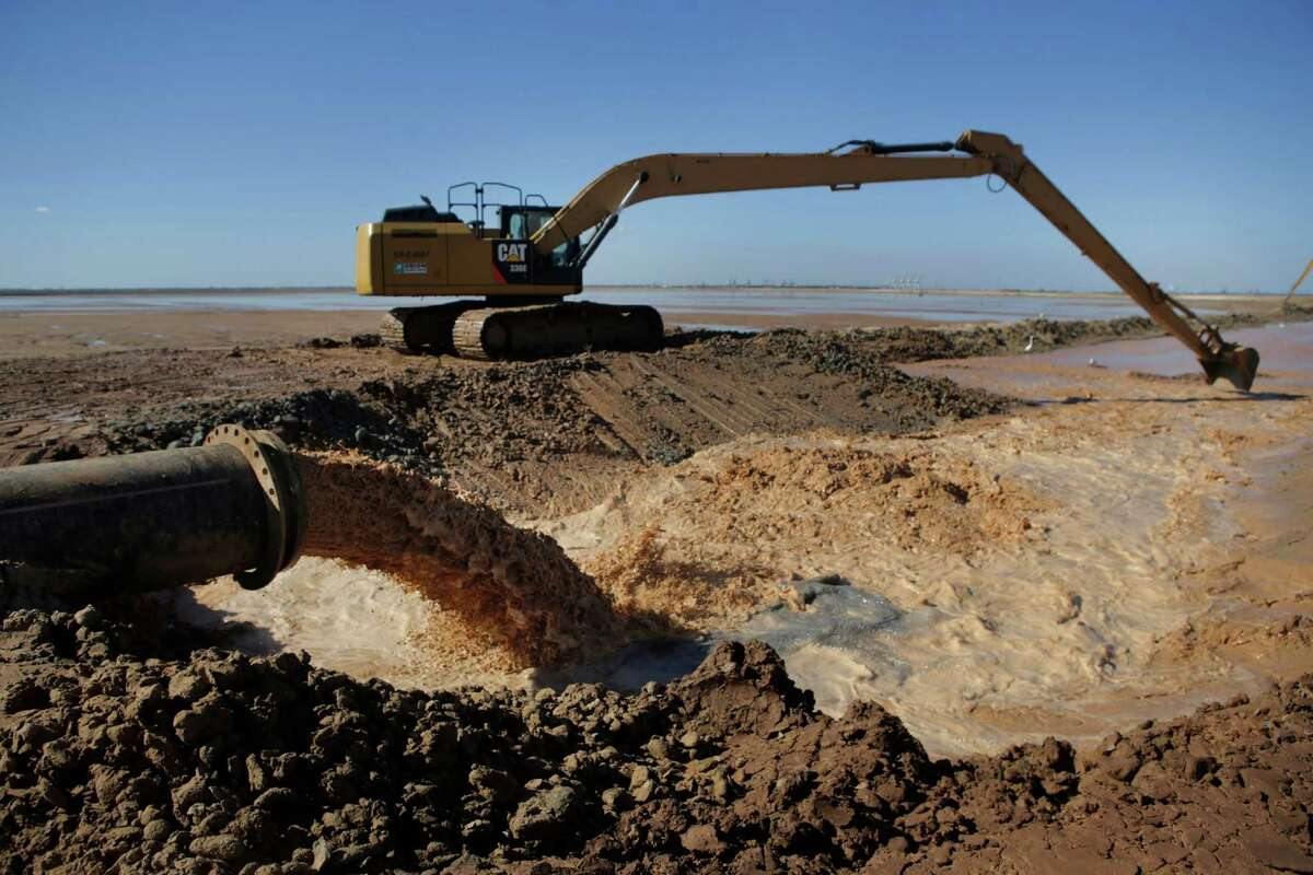 Dredged material from the Houston Ship Channel reaches its destination at Placement Area 15 after traveling through 24-inch diameter pipe at 19,000 gallons per minute. The dredged material is being turned into marsh areas.