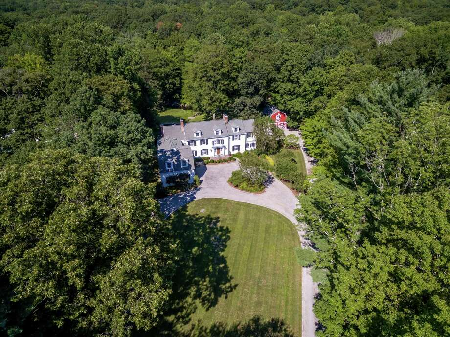 An aerial view of the property at 447 Valley Road underscores the amount of privacy it enjoys with its thick border of mature trees, yet it is convenient to downtown boutiques and the train station.