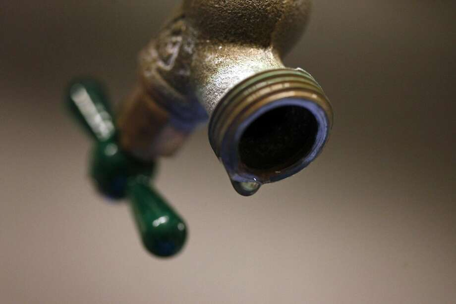 A drip sits on the edge of the faucet. Photo: Lacy Atkins, The Chronicle