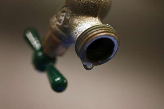 A drip sits on the edge of the faucet after water has been taken to test at the Living Machine at the San Francisco Water Power Sewer building, Friday January 31, 2014, in San Francisco, Calif.