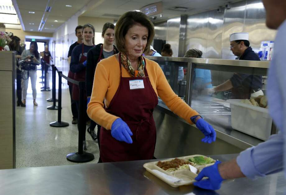 Rep. Nancy Pelosi delivers a lunch plate of pasta fagioli to guests at the St. Anthony's Foundation dining room in San Francisco, Calif. on Wednesday, Nov. 23, 2016. Volunteering during the holiday season is an annual activity for Pelosi. Photo: Paul Chinn, The Chronicle