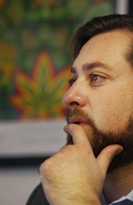 Cannabis attorney Joe Rogoway looks over applications for new hires in his S.F. office. Photo: Leah Millis, The Chronicle