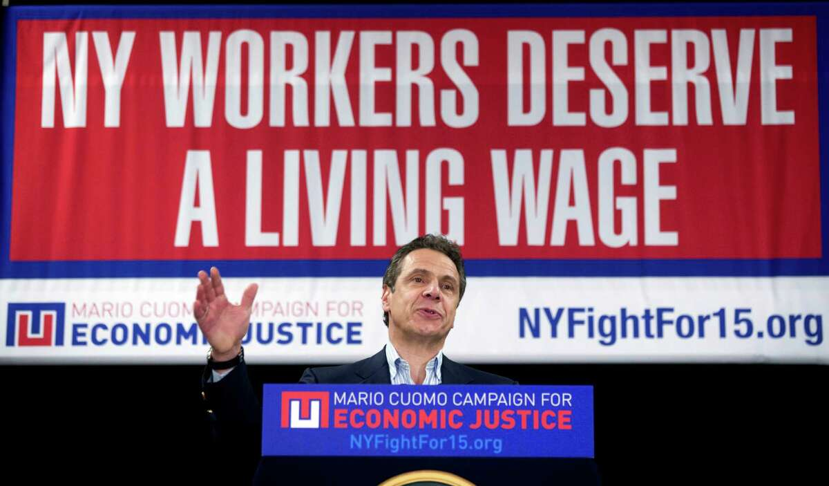 FILE - In this Feb. 25, 2016 file photo, New York Gov. Andrew Cuomo speaks during a rally to raise the minimum wage in Albany, N.Y. A federal court on Tuesday, Nov. 22, 2016, blocked implementation of a rule imposed by President Barack Obama's administration that would have made an estimated 4 million more higher-earning workers across the country eligible for overtime pay starting Dec. 1. The U.S. District Court in the Eastern District of Texas granted the nationwide preliminary injunction that prevents the Department of Labor from implementing the changes while the regulation's legality is examined in more detail by the court. (AP Photo/Mike Groll, File)