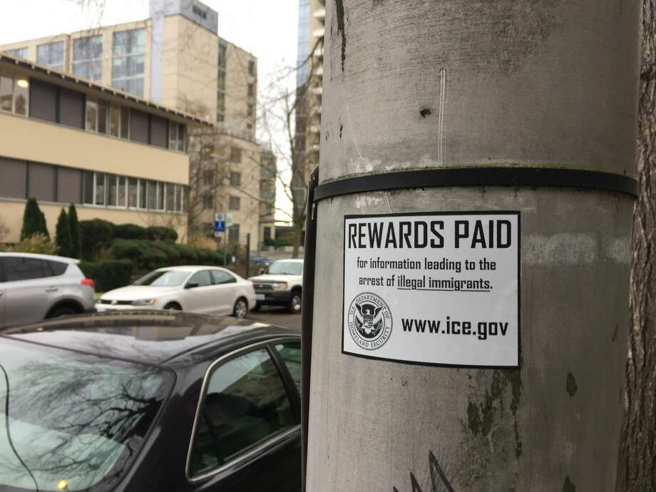 "Anonymous stickers falsely advertising ""rewards paid for information leading to the arrest of illegal immigrants"" are cropping up in Seattle. They carry the Homeland Security Department emblem as well as the ICE website, ICE.gov. And they're totally bogus. The one pictured above was spotted on Seattle's First Hill.  Photo: LEVI PULKKINEN / SEATTLEPI.COM"