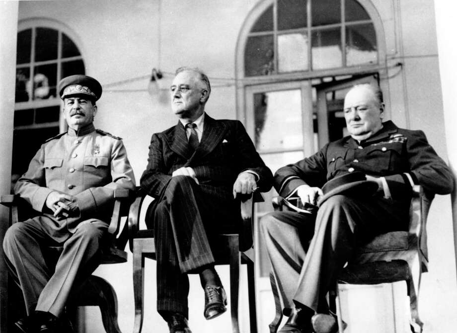 In this Nov. 28, 1943 file photo, Soviet Union Premier Josef Stalin, U.S. President Franklin D. Roosevelt, center, and British Prime Minister Winston Churchill sit together during the Tehran Conference in Tehran, Iran. The three leaders, meeting for the first time, discussed Allied plans for the war against Germany and for postwar cooperation in the United Nations. Photo: Associated Press / AP