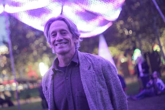 """Christopher Schardt, artist and technology innovator,  with his piece """"Firmament"""" on display at Discovery Green this holiday season include, photographed on Monday, Nov. 21, 2016, in Houston. ( Elizabeth Conley / Houston Chronicle )"""
