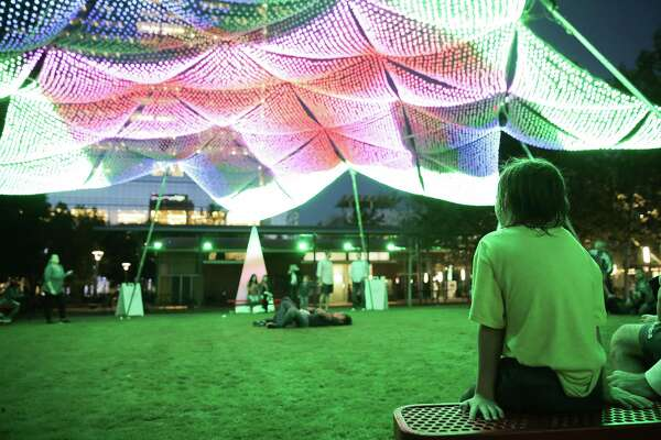 """Onlookers take in """"Firmament"""" by artist and technology innovator Christopher Schardt at Discovery Green on Monday, Nov. 21, 2016, in Houston. ( Elizabeth Conley / Houston Chronicle )"""