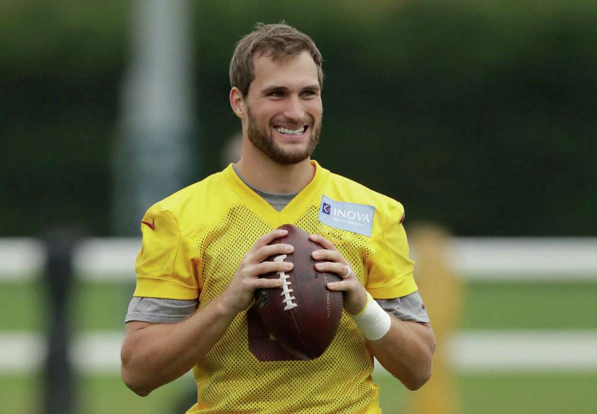 Washington Redskins' quarterback Kirk Cousins, 8, takes part in a training session at Wasps rugby union team training ground in west London, Friday, Oct. 28, 2016. The Washington Redskins are due to play the Cincinnati Bengals at Wembley stadium in London on Sunday in a regular season NFL game. (AP Photo/Matt Dunham)