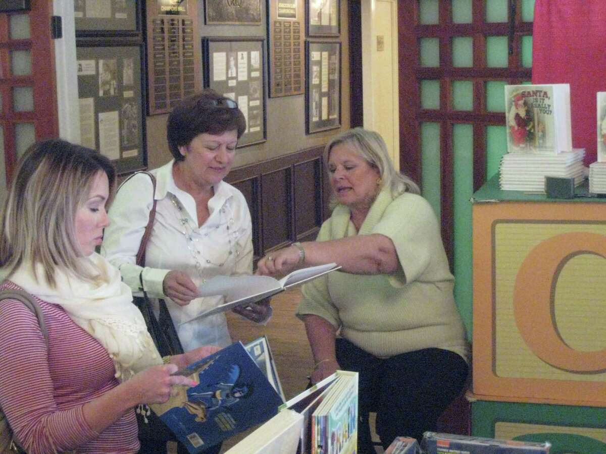 Author Marilyn Harkrider shares stories from her books with guests at the Kingwood Mistletoe Market at The Overlook Tuesday, Nov. 22.