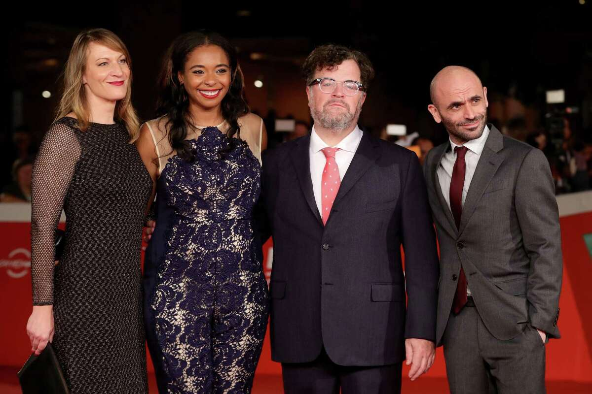 Producers Lauren Beck, left, and Kimberly Steward, director Kenneth Lonergan and producer Bill Migliore walk a red carpet for