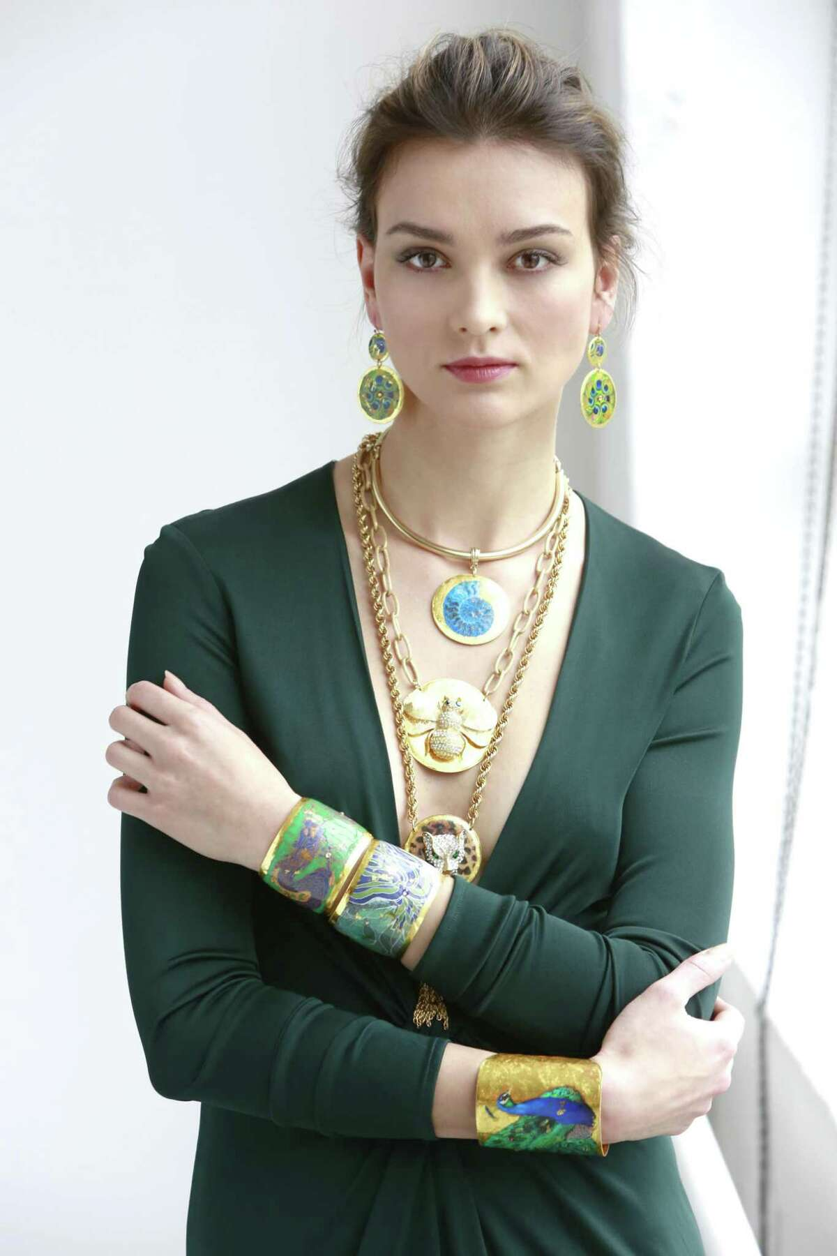 A model wears several pieces from the Evocateur line, created and founded by Westport resident Barbara Ross-Innamorati. In seven years, she has launched multiple collections of bangles, cuffs, necklaces and earrings that are inspired by her interests, including art, travel and Old World civilizations.