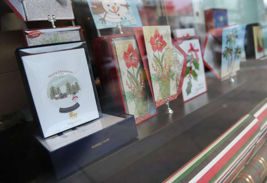To send or not to send? Papyrus displays Christmas cards in the window of its store on Greenwich Avenue in Greenwich, Conn. Photo: Tyler Sizemore, Hearst Connecticut Media