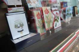 Papyrus displays Christmas cards in the window of its store on Greenwich Avenue in Greenwich, Conn. Wednesday, Nov. 9, 2016.