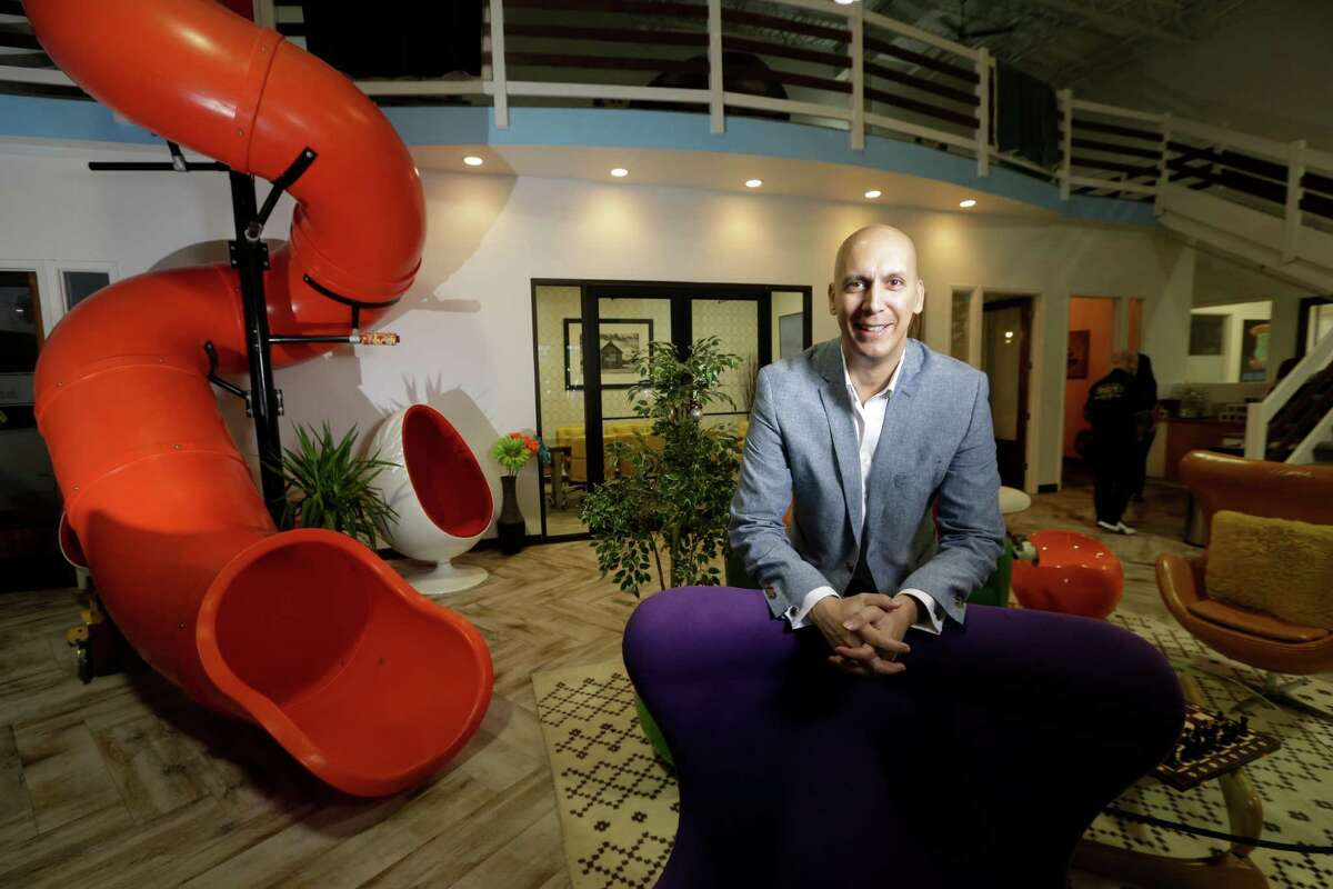 Mike Thakur, founder, poses in the fun common area at The Work Lodge, a co-working space he established in the Vintage Park, 118 Vintage Park Blvd., Wednesday, Nov. 23, 2016, in Houston. ( Melissa Phillip / Houston Chronicle )