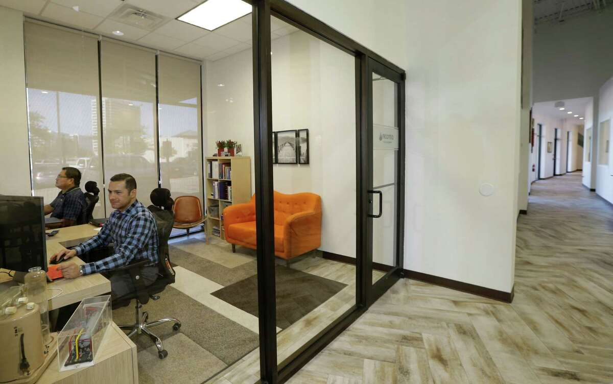 Arnel Bartolome, left, and Diego Alvarez, right, mangers of Ficoteq, an oil field equipment supplier, work in their office at The Work Lodge, a co-working space in the Vintage Park, 118 Vintage Park Blvd., Wednesday, Nov. 23, 2016, in Houston. ( Melissa Phillip / Houston Chronicle )