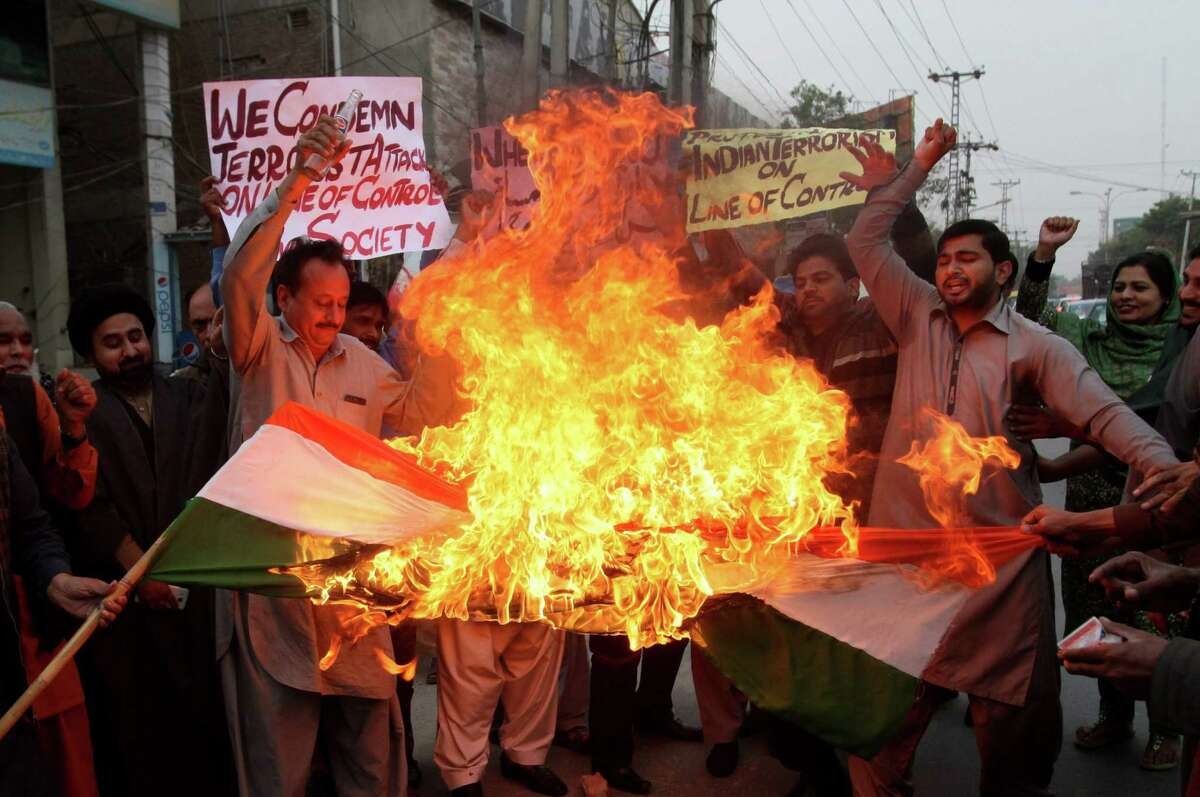 Pakistan protesters on Wednesday burn a representation of an Indian flag to condemn recent firing, including deadly attacks on a passenger bus, at the Line of Control, in Multan, Pakistan.