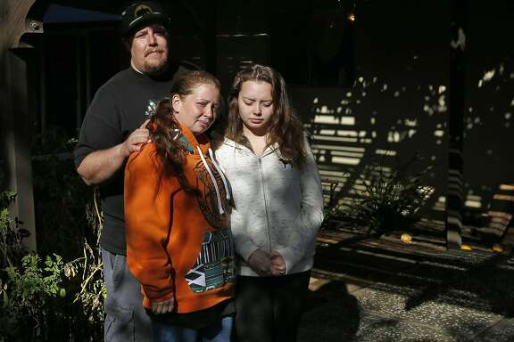 Chris Phillips, his wife Michele Sunderland and Sunderland's daughter Haylie Sunderland, 18 pictured outside of their home Nov. 23, 2016 next to some of their tomato plants which were mistaken by police as cannabis plants when they were raided over the summer in Livermore, Calif. Phillips and his wife Michele Sunderland are part of a medical cannabis collective and both run medical cannabis businesses. In June Phillips' home was raided by the police and Phillips was arrested along with his brother and a few colleagues. The bail cost the group everything they had plus money they were able to raise from the community. Now Phillips and his wife face eviction because the police sent a letter to their landlord stating that there had been criminal activity in the home, says Phillips.