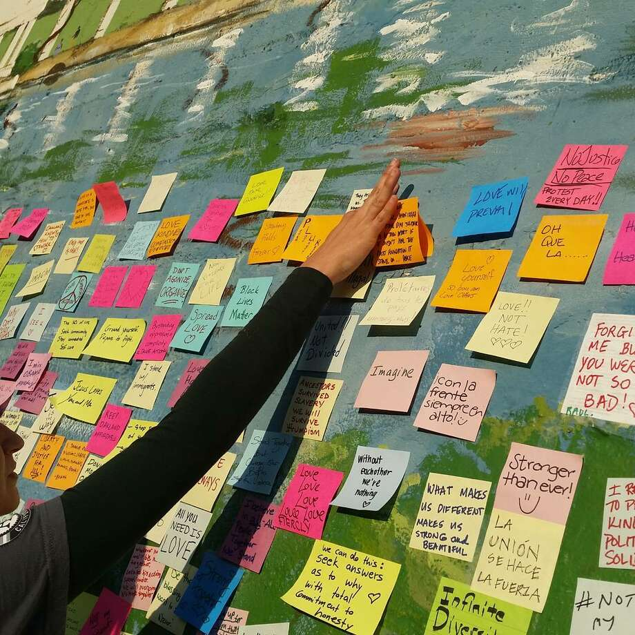 Handwritten messages on Post-It notes were left on a Lakeshore Avenue wall in the days following the presidential election. The messages were later removed by a local man who was worried about the damage to the mural. Photo: Courtesy Pamela Drake