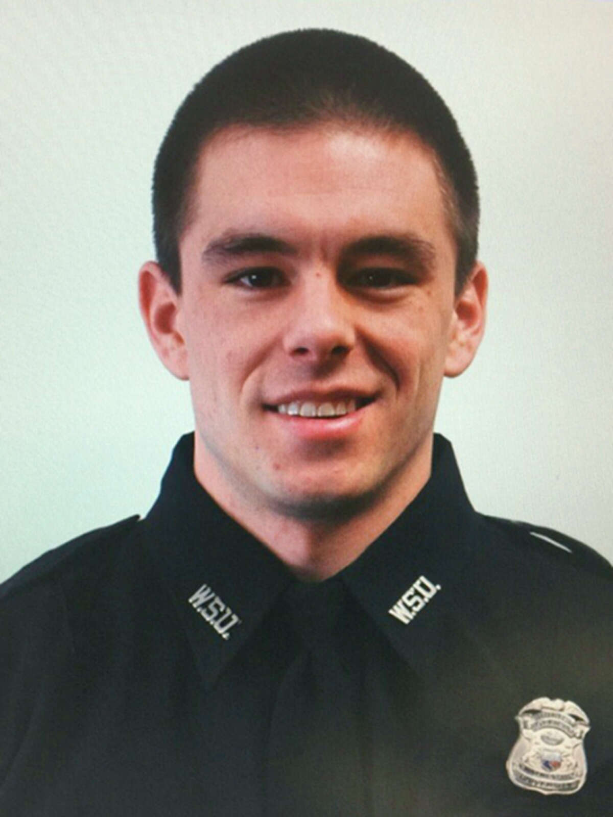 This undated photo provided by Wayne State University shows university police officer Collin Rose, who was shot in the head while on patrol near a university campus in Detroit on Tuesday, Nov. 22, 2016. Rose is a five-year veteran of the department who works in the canine unit. (Wayne State University via AP)