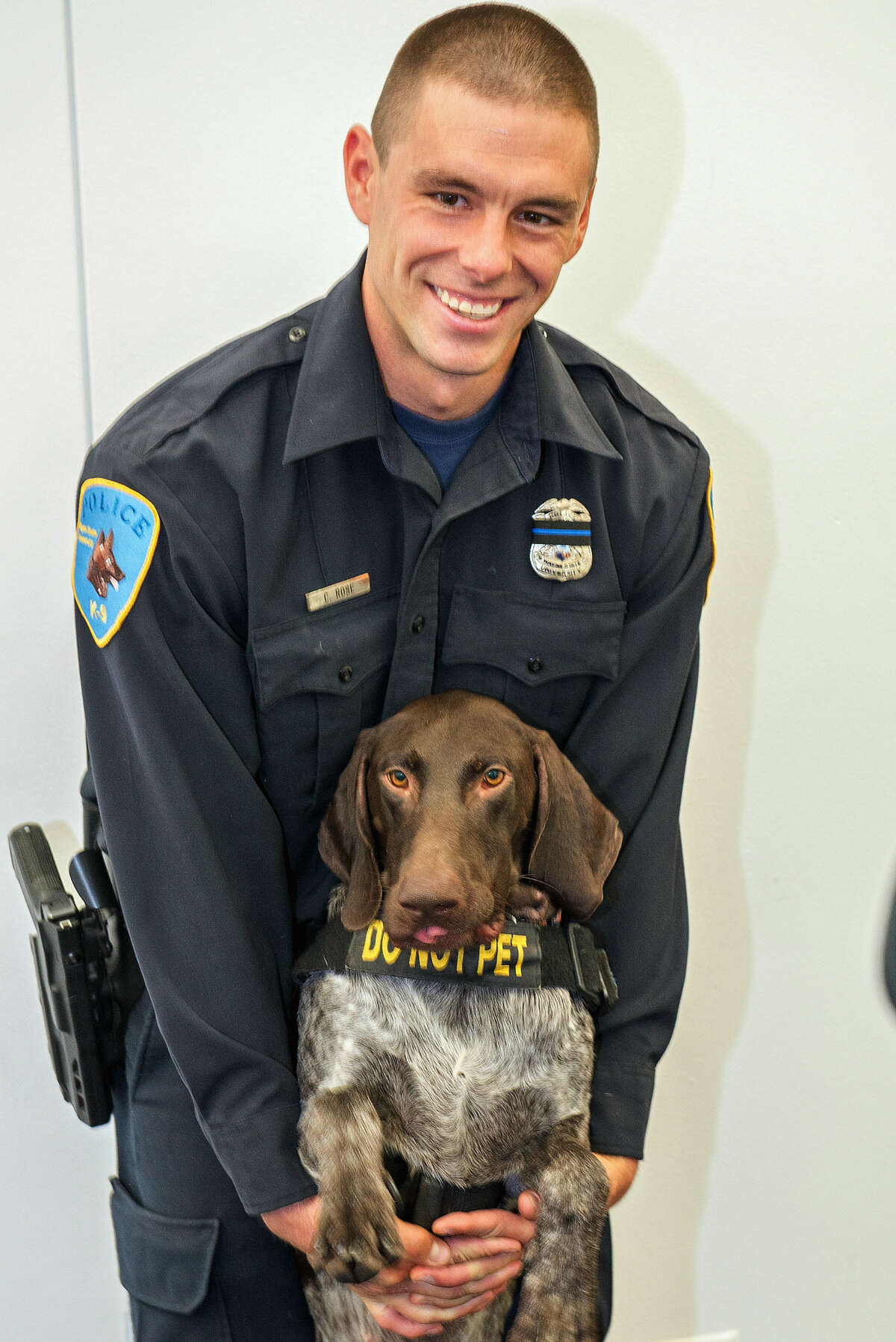This undated photo provided by Wayne State University shows university police officer Collin Rose, who was shot in the head while on patrol near a university campus in Detroit on Tuesday, Nov. 22, 2016. Rose is a five-year veteran of the department who works in the canine unit. (MJ Murawka/Wayne State University via AP)