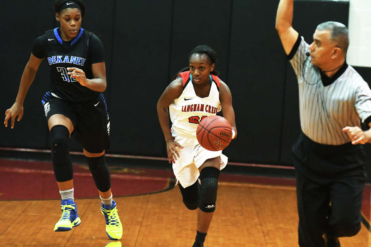 Langham Creek sophomore guard Dyani Robinson brings the ball up the court against Dekaney in Monday's win. Robinson led all scorers with 28 points, including three makes from behind the arc.