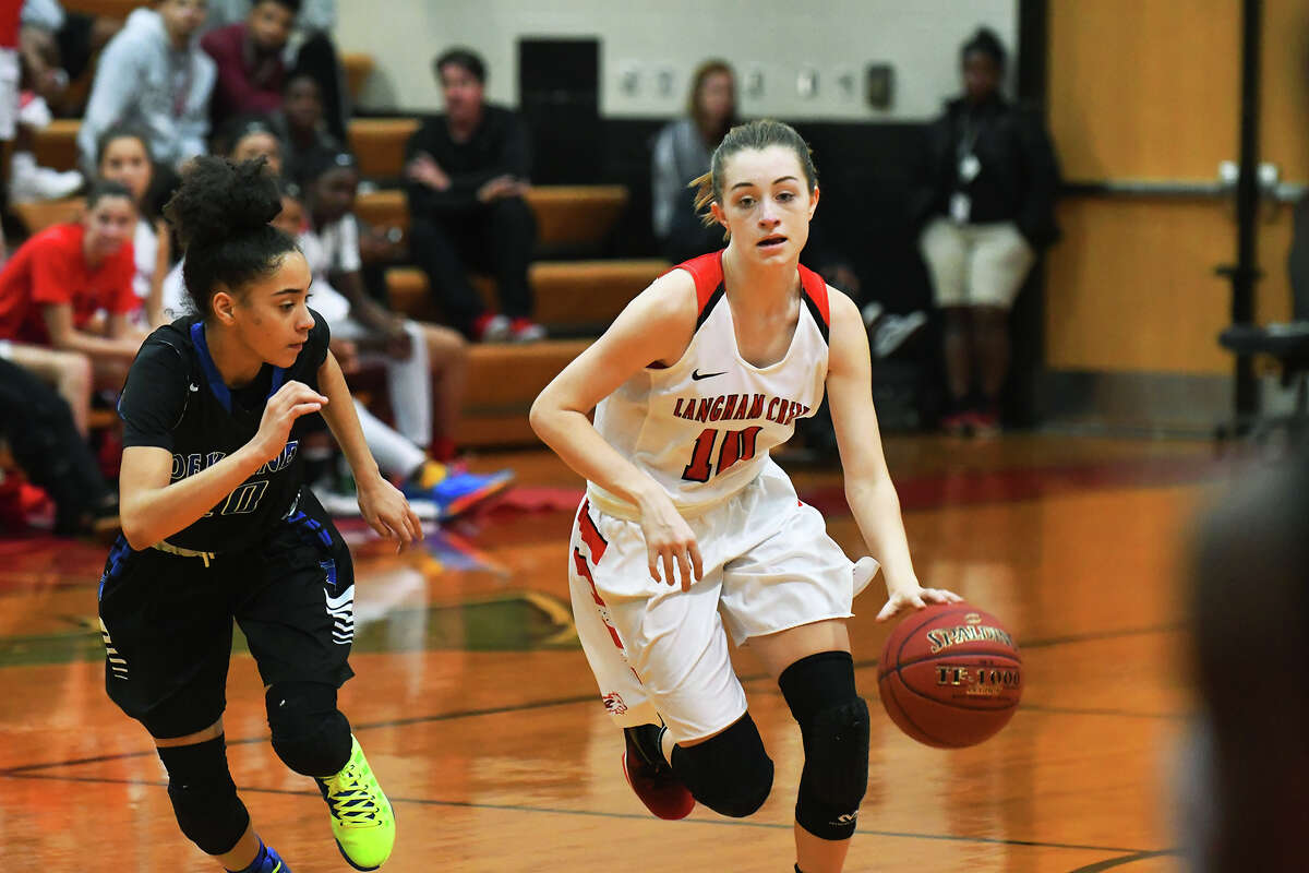 Langham Creek sophomore guard Briley Perkins operates the fast break against Dekaney Monday at Langham Creek High School. Perkins logged 18 points and three assists in the contest, running the offense with poise and precision.
