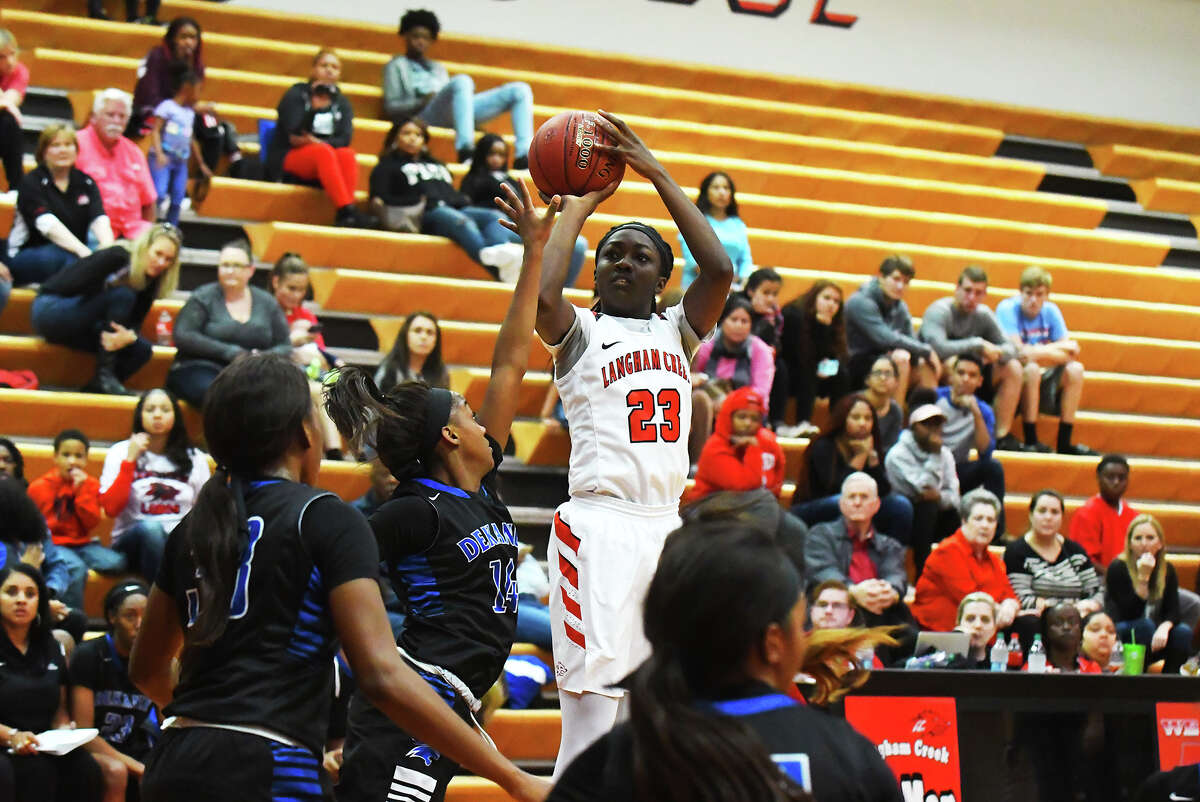 Langham Creek senior guard Kayla Owens connects on a three-pointer early in Monday's matchup with Dekaney. Owens scored six points in the contest, and also added two blocks, three steals and two assists, stuffing the stat sheet.