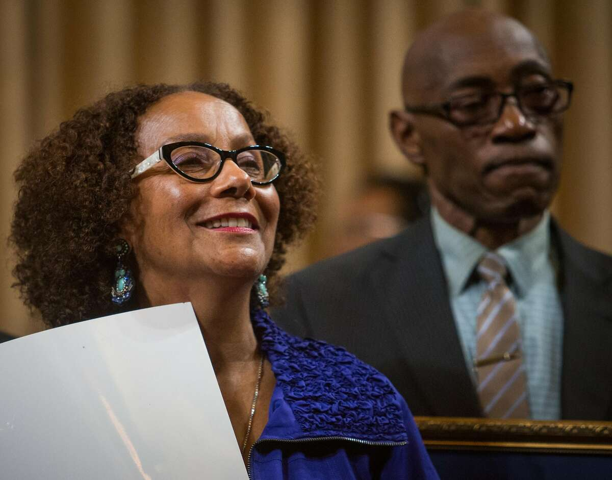 Gay Plair Cobb, CEO of the Oakland Private Industry Council, is honored by city officials for 30 years of providing jobs to Oakland residents during the City Council meeting at City Hall on Tuesday, Oct. 20, 2015 in Oakland, Calif.