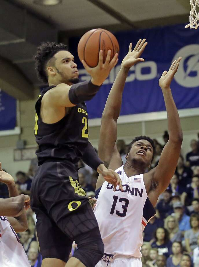 Oregon forward Dillon Brooks, who had 15 points, heads to the basket against Connecticut forward Steven Enoch. Photo: Rick Bowmer, Associated Press