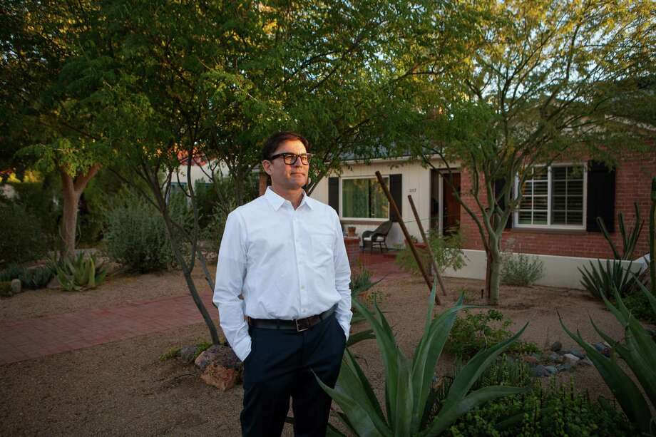Luis Solis, a Phoenix real estate broker, said some of his clients have ramped up their searches this week.  Photo: DAVID JOLKOVSKI, STR / NYTNS