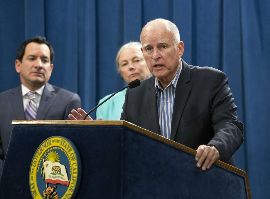 Gov. Jerry Brown, with Assembly Speaker Anthony Rendon (left) and state Sen. Fran Pavley, discusses the 10-year extension of the state's climate change law. Photo: Rich Pedroncelli, Associated Press