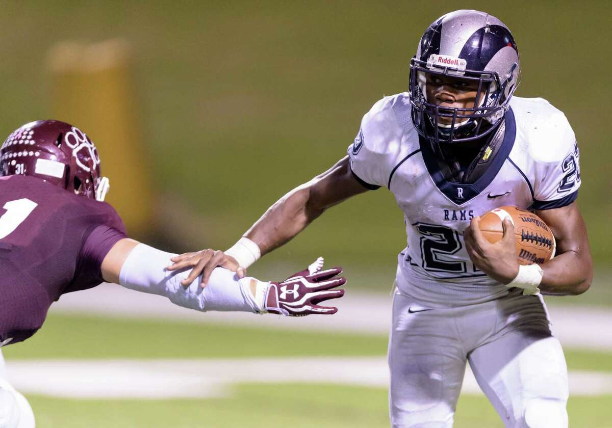 Trelon Smith (22) of the Cy Ridge Rams runs around left end in the second half against the Cy Fair Bobcats in a high school football game on Thursday, October 1, 2015 at Pridgeon Stadium.
