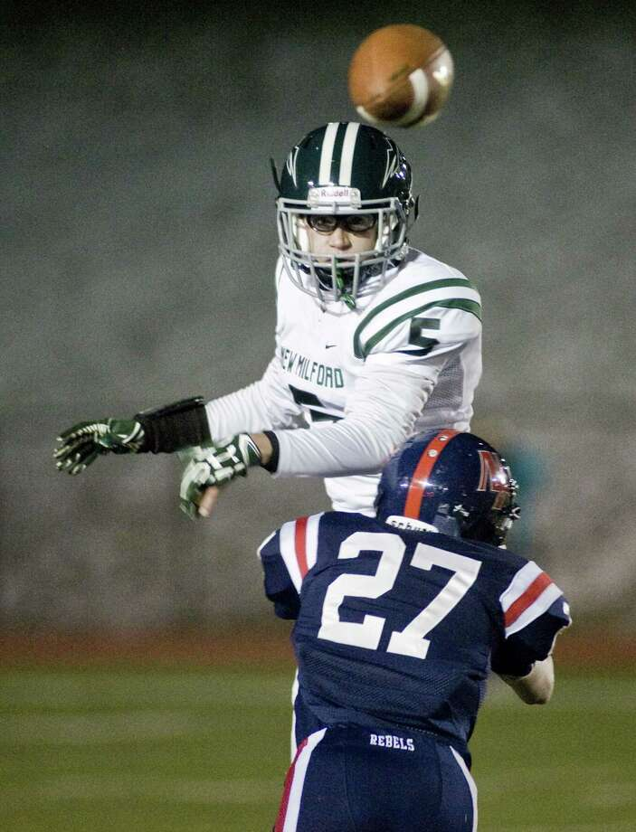 New Milford High School's Max Vaughey tries to receive a pass while being hit by New Fairfield High Schhol's Liam Rattigan during a game at New Fairfield. Wednesday, Nov. 23, 2016 Photo: Scott Mullin / For Hearst Connecticut Media / The News-Times Freelance