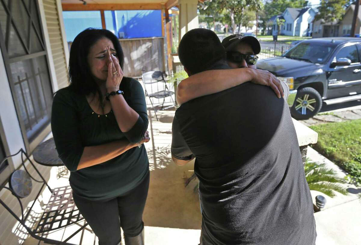 """Anna Vasquez (right) receives a hug from Carlos Gonzales - the son of Cassandra Rivera (left) after they received word of their exoneration on Wednesday, Nov. 23, 2016. Vasquez, Rivera and Elizabeth Ramirez - three of the """"San Antonio Four"""" along with family and friends gathered to react to the news of being exonerated by the Texas Court of Criminal Appeals for being convicted of sexual assault of two young girls in 1990s. Kristie Mayhugh was not present at the gathering due to work. (Kin Man Hui/San Antonio Express-News)"""
