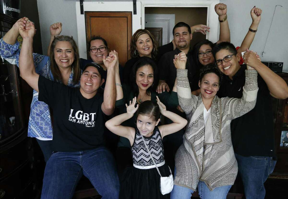 """Three of the """"San Antonio Four"""" along with family and friends gather to react to the news of being exonerated by the Texas Court of Criminal Appeals for being convicted of sexual assault of two young girls in 1990s. Anna Vazquez (from left, front), Cassandra Rivera and Elizabeth Ramirez met with media on Wednesday, Nov. 23, 2016 as news emerged of their exoneration. Kristie Mayhugh was not present at the gathering due to work. (Kin Man Hui/San Antonio Express-News)"""